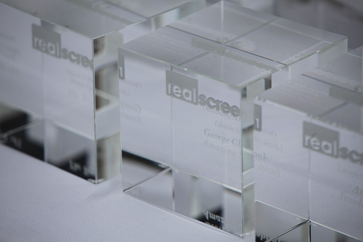 a group of Realscreen Awards trophies